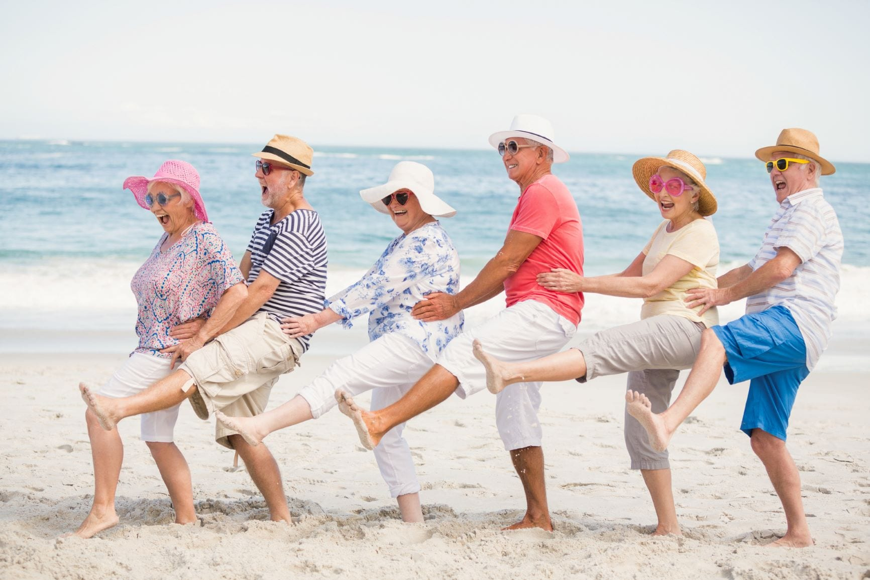 Older adults celebrating on the beach
