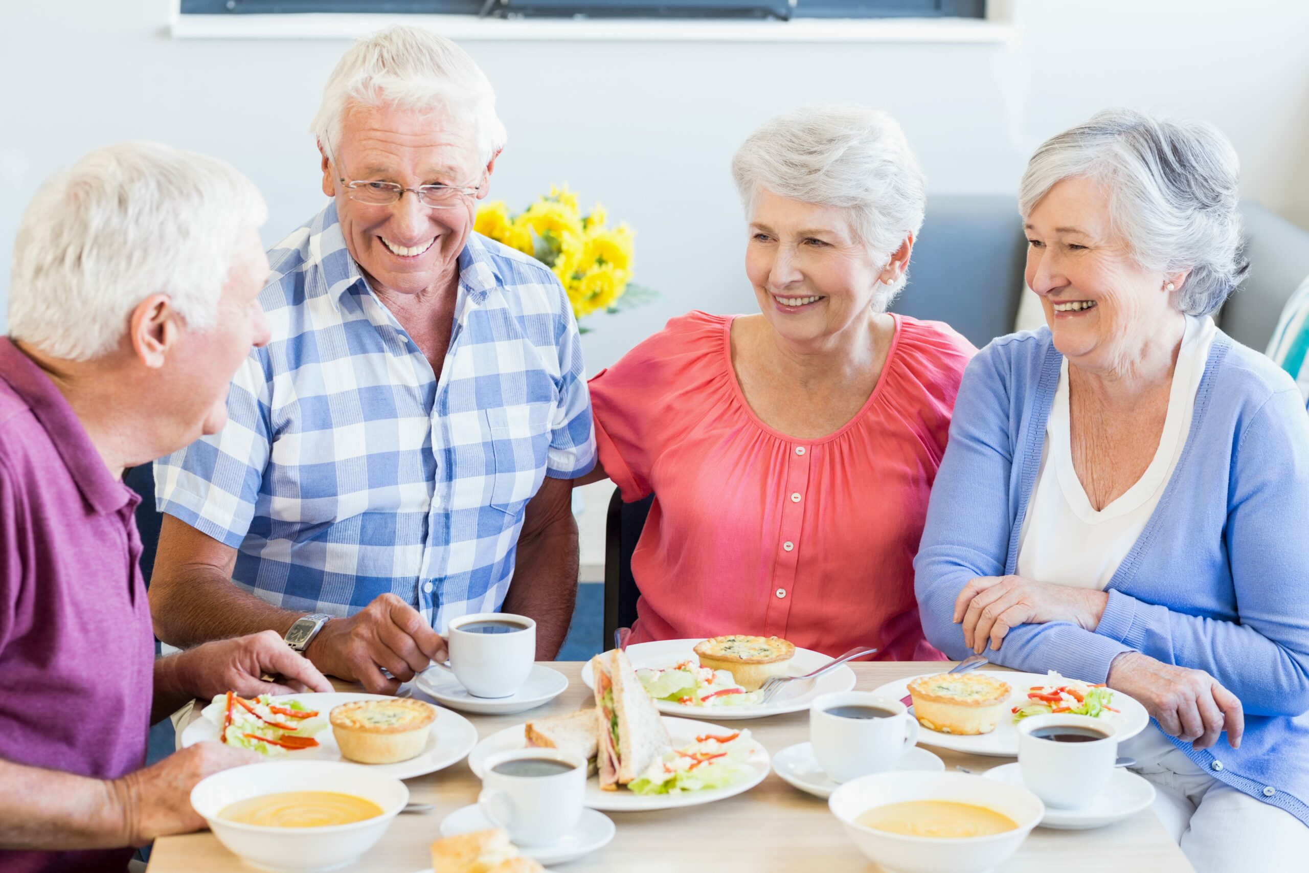 Older adults in nursing home eating a balanced meal