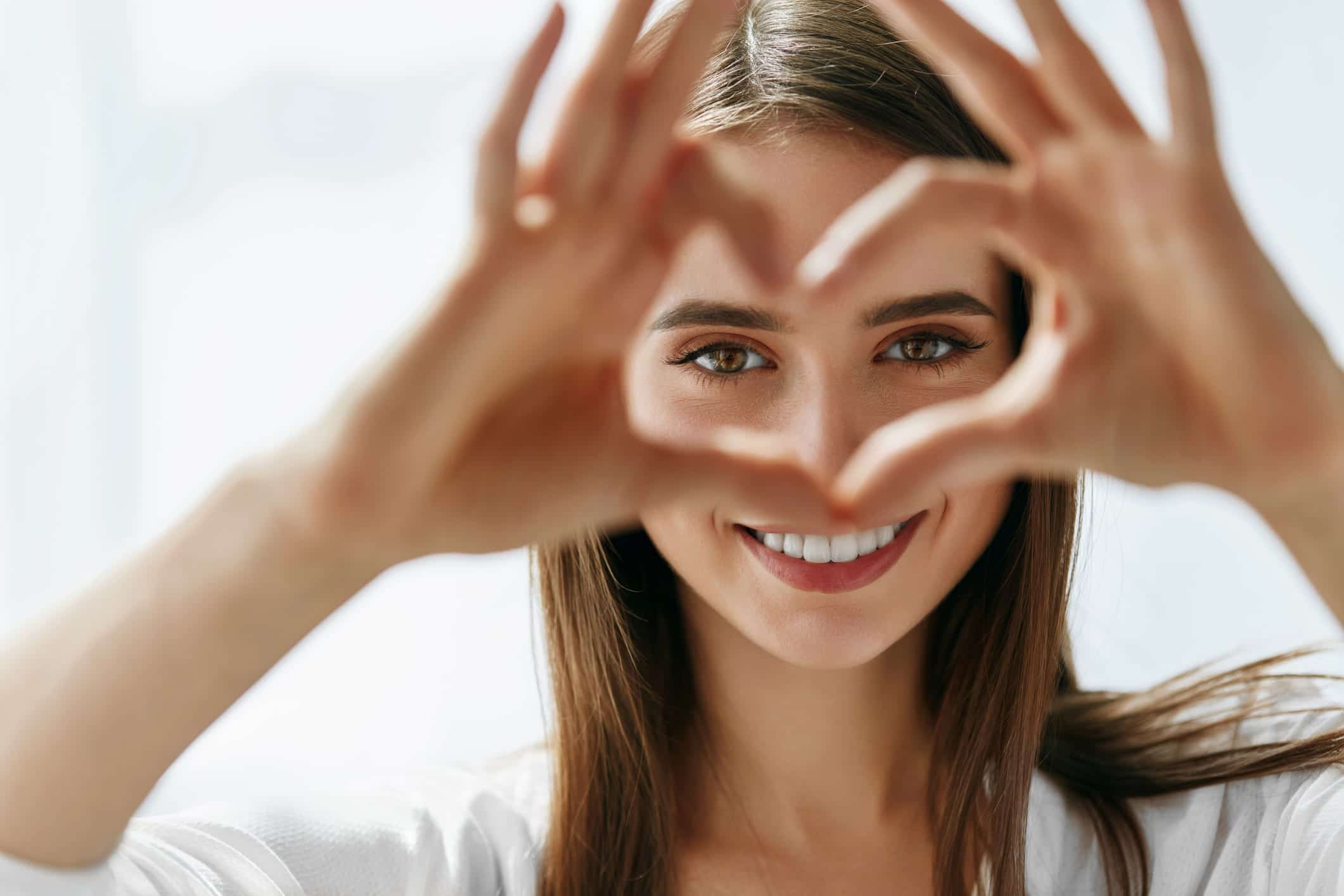 Woman making heart with her hands