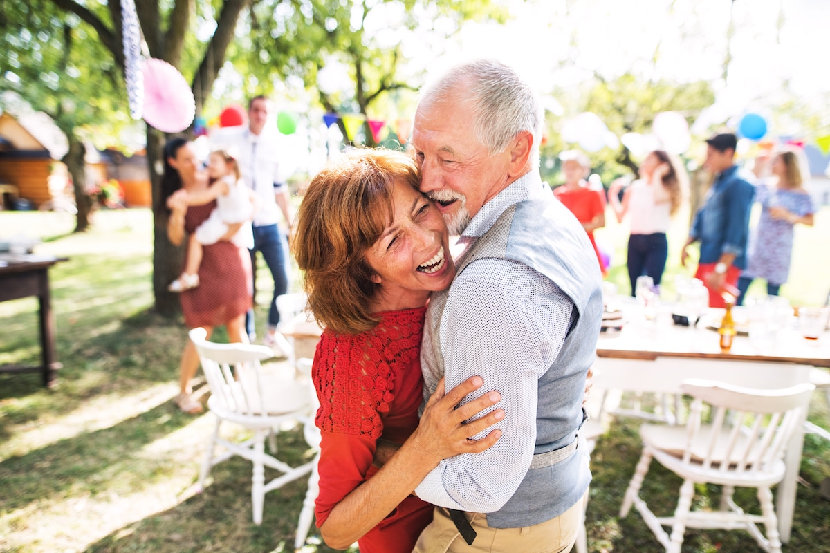 Older couple dancing at outdoor party
