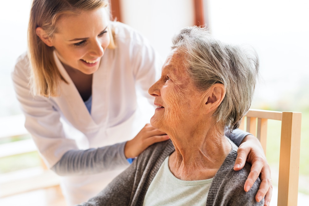 Health professional with elderly woman