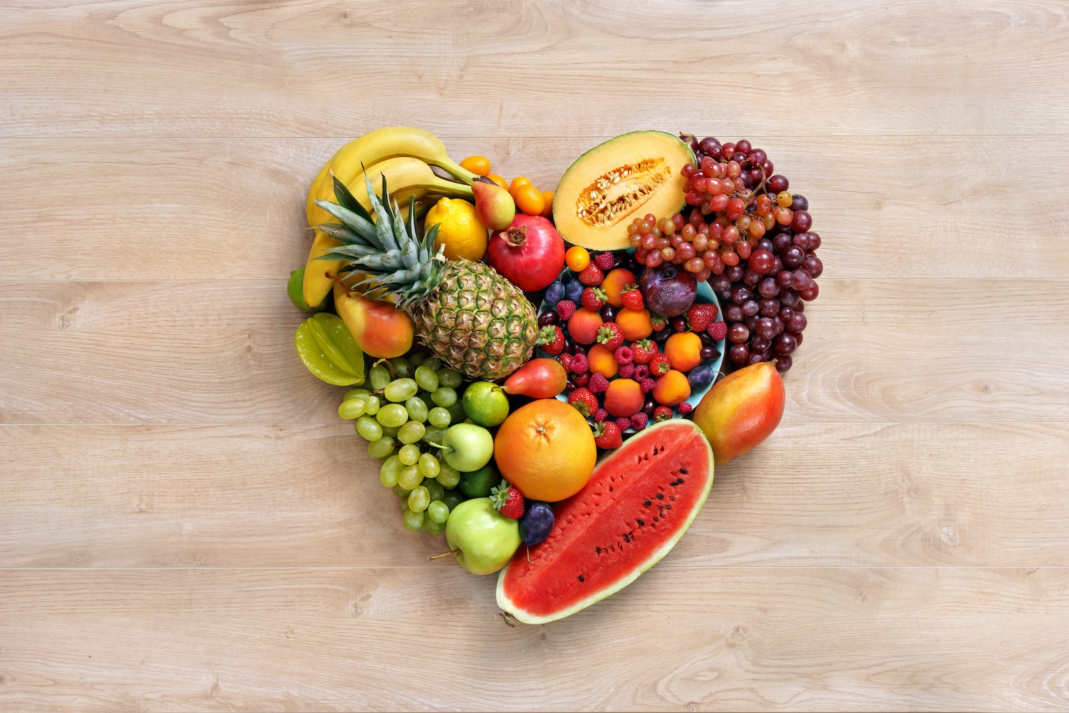 Heart healthy foods in the shape of a heart