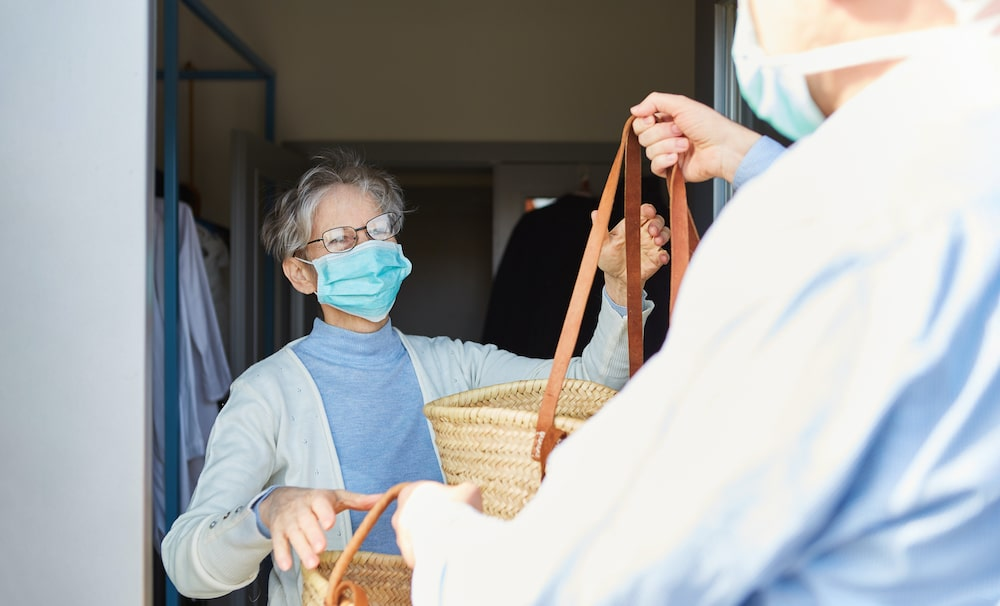 Food delivery service for elderly woman during COVID-19 pandemic