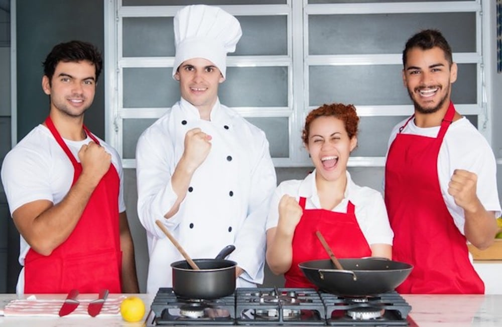 People cooking in kitchen.