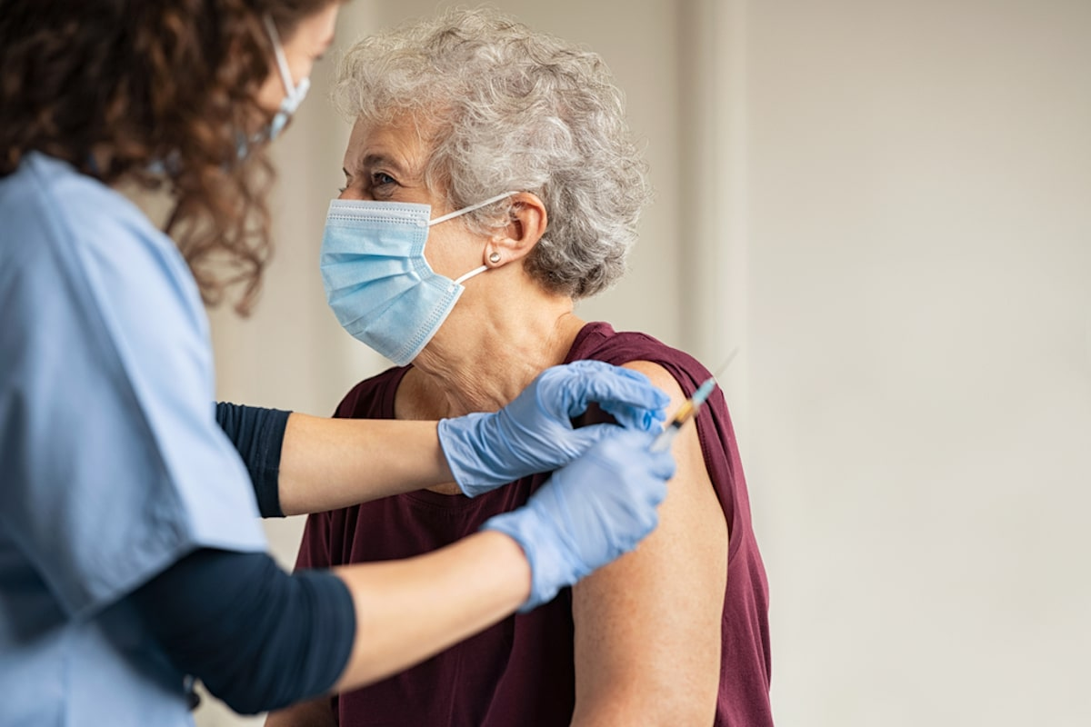 Elderly woman getting COVID-19 vaccine