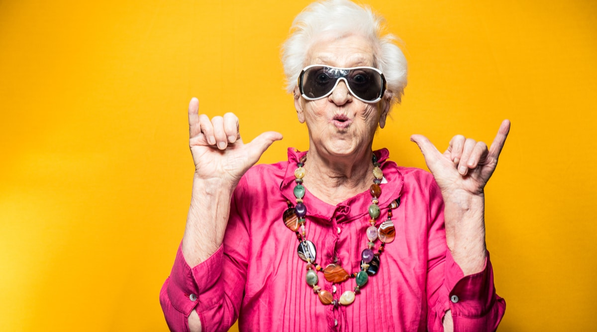 Happy old woman with sunglasses